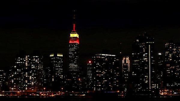 The Empire State Building is lit in red and yellow to honor the 60th anniversary of the founding of the Peoples Republic of China in this photo taken from across the East River Wednesday, Sept. 30, 2009 in the Queens borough of New York. The color scheme has caused controversy among critics of the Chinas communist government. (AP Photo/Jason DeCrow)