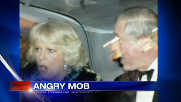 Protesters hurl objects at Prince Charles and Camilla's car