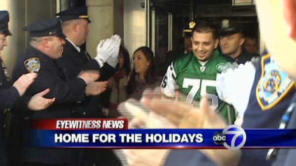 Wounded NYPD officer returns home from hospital