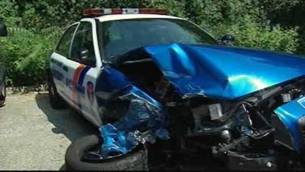 Drunken driver collides with police car