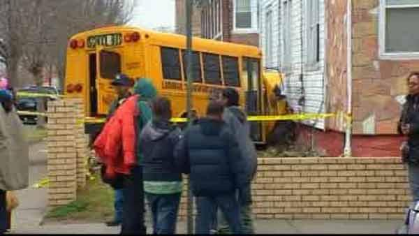 School bus crashes into house, injures six people