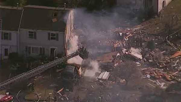 Two firefighters injured in townhouse explosion