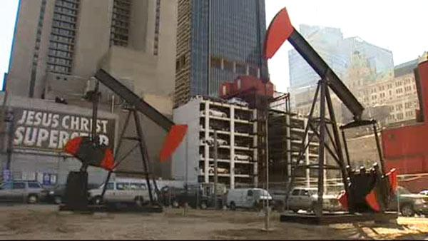 Vacant lot transformed into oil field art