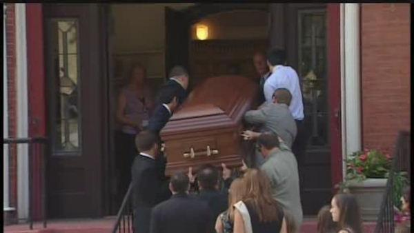 Funeral for boy who died in capsized boat