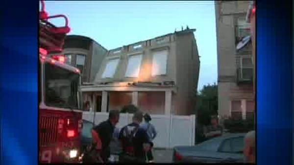Neighbors forced from homes when building partially collapses