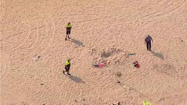 Child trapped as sand collapses in Long Branch
