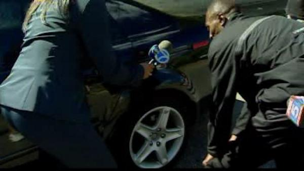 Young boy trapped under car during carjacking