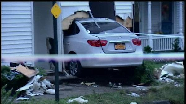 Suspect charged with drunk driving after running car into home