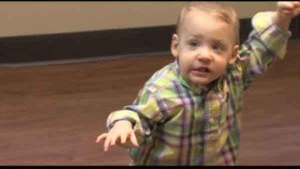 Prematurely-born boy takes 1st steps on prosthetic