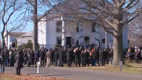 Six more services are held for Newtown school shooting victims today