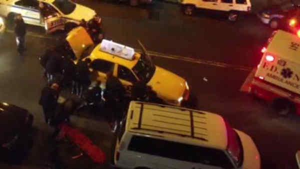 Officers rescue man pinned by a taxi