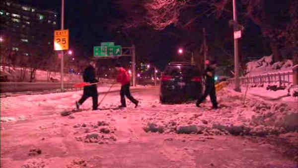 New York City clearing sidewalks, streets after snowfall