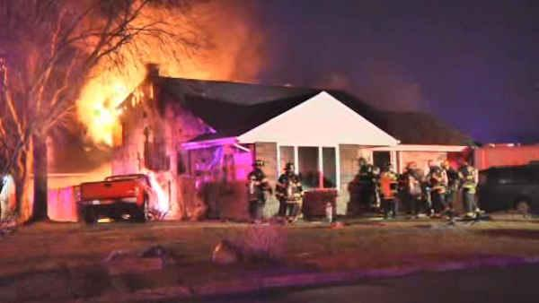 Huge fire sparked when car crashes into home