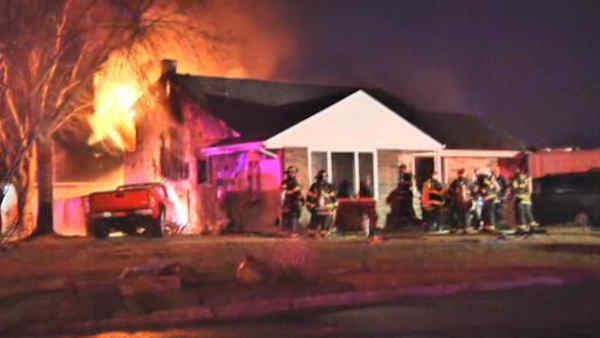 Firefighter's house goes up in flames after car crashes into it