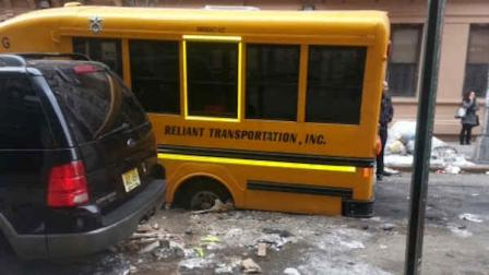 mini school bus in sinkhole