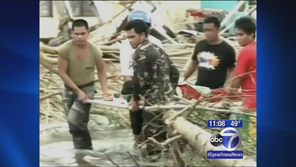 Typhoon survivors in Philippines struggle for aid