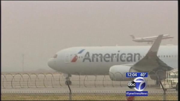 Holiday travelers look to depart before storm