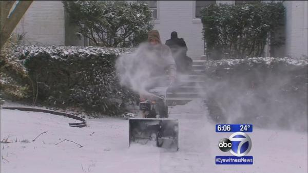 Long Island residents pulling out snowblowers to clear away snow