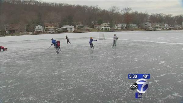 Two skaters fall into the ice at Indiana Lake