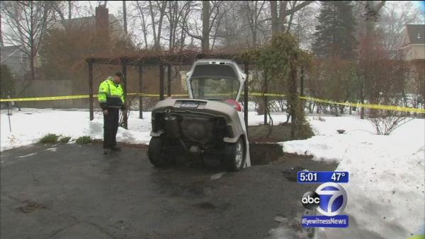 Woman safe after ground caves, swallows her and car