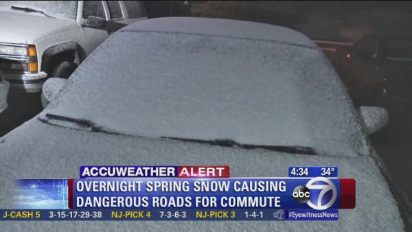 Spring snow coats cars, slicks roads