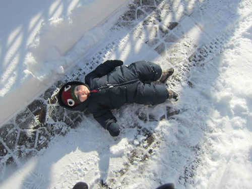 Lying down in the snow!