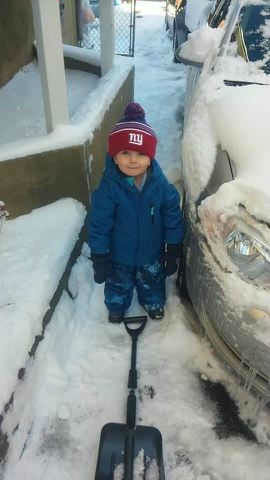Helping Dad shovel in Bogota, New Jersey.