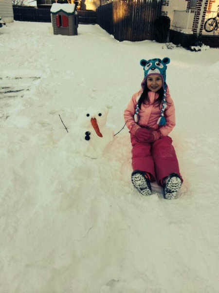 "<div class=""meta ""><span class=""caption-text "">Kim and her snowman! </span></div>"