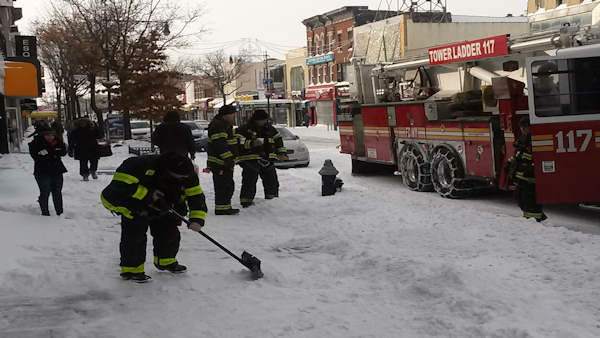 Firefighters help shovel out Steinway St. in Astoria.  <span class=meta>(WABC Photo)</span>