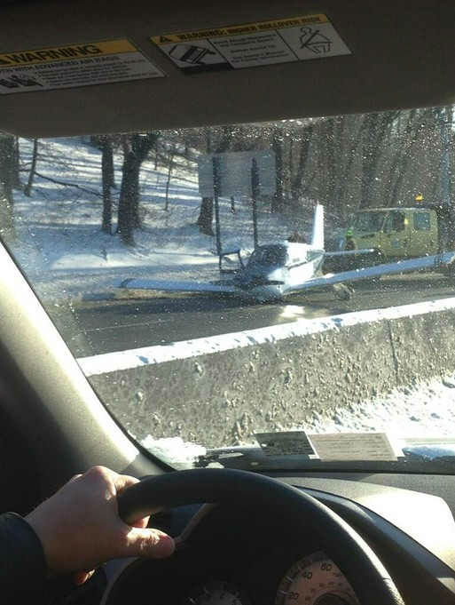 A small plane with three people on board made an emergency landing on the Major Deegan Expressway in the Bronx. <span class=meta>(Daniel Miller)</span>