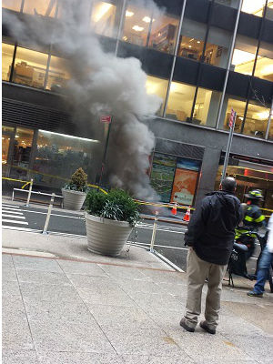 "<div class=""meta ""><span class=""caption-text "">Several floors of a building were evacuated after a transformer fire on West 51st Street in Midtown.   (Photo/Madison Bohunicky)</span></div>"