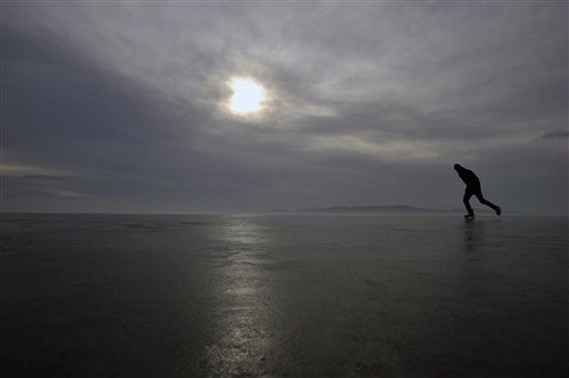 "<div class=""meta ""><span class=""caption-text "">A man skates on the frozen surface of the Lake Balaton off the coast of Balatonfured, Hungary, Saturday, Jan. 8, 2011. Air temperature stayed way below the freezing point for months creating a safe ice for winter activities on the Balaton, Central Europe's largest lake. (AP Photo/Bela Szandelszky) (AP Photo/ Bela Szandelszky)</span></div>"