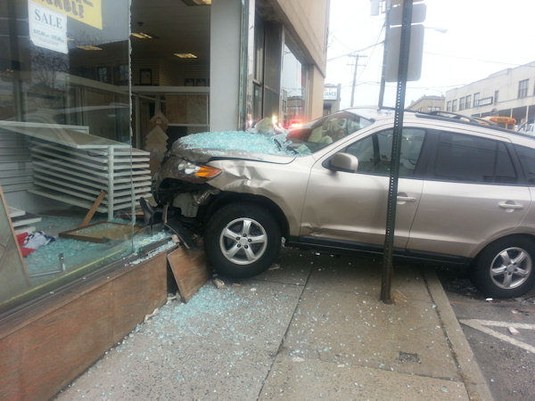 Photos from the scene of a 2 vehicle accident in which one of them ended up crashing into a tile store in Freeport, Long Island.