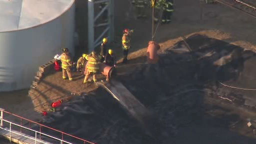 "<div class=""meta image-caption""><div class=""origin-logo origin-image ""><span></span></div><span class=""caption-text"">Rescue crews on the scene in Manalapan Township, New Jersey where a person apparently climbed into a pipe at United Water and became stuck.  (Photo/NewsCopter 7)</span></div>"