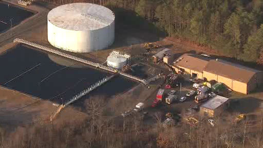 "<div class=""meta ""><span class=""caption-text "">Rescue crews on the scene in Manalapan Township, New Jersey where a person apparently climbed into a pipe at United Water and became stuck.  (Photo/NewsCopter 7)</span></div>"
