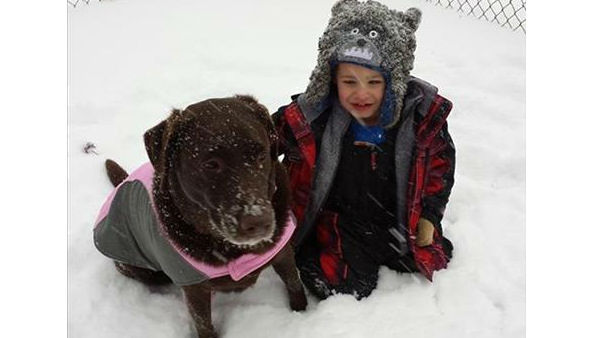 Hershee and Jacob playing in the snow