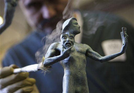 "<div class=""meta image-caption""><div class=""origin-logo origin-image ""><span></span></div><span class=""caption-text"">Craftsman Ricardo Godinez applies a green-black patina coating to a statuette being finished for the 17th Annual Screen Actors Guild Awards at the American Fine Arts Foundry on Friday, Jan. 21, 2011 in Burbank, Calif. The SAG Awards will be held in Los Angeles on Sunday, Jan. 30. (AP Photo/Damian Dovarganes) (AP Photo/ Damian Dovarganes)</span></div>"