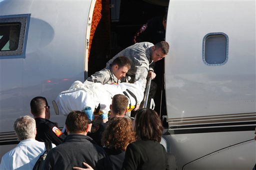 In this photo released by the office of Rep. Gabrielle Giffords, D-Ariz., Rep. Giffords is loaded onto an airplane in Tucson, Ariz., as she is transferred to a rehabilitation center in Houston, Friday, Jan. 21, 2011. Giffords is recovering from a gunshot wound to the head. &#40;AP Photo&#47;Office of Rep. Giffords, Jennifer Polixenni Brankin&#41; MANDATORY CREDIT <span class=meta>(AP Photo&#47; Jennifer Polixenni Brankin)</span>