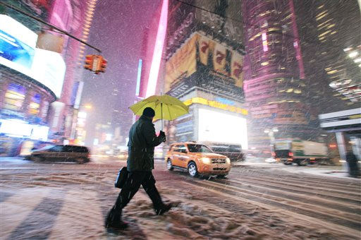 "<div class=""meta ""><span class=""caption-text "">A pedestrian makes his way through Times Square, Friday, Jan. 21, 2011 in New York. Snow in the New York City area is causing hazardous road conditions but should move out of the area by late morning. (AP Photo/Mark Lennihan) (AP Photo/ Mark Lennihan)</span></div>"