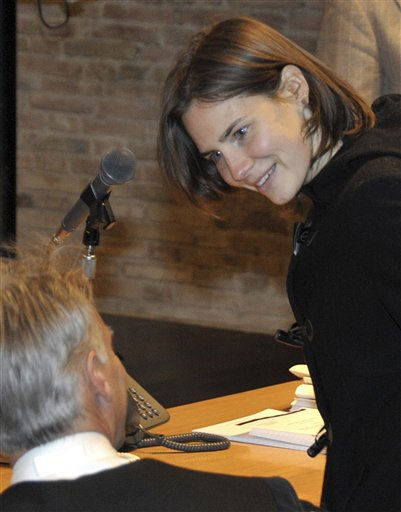 "<div class=""meta ""><span class=""caption-text "">Convicted U.S. student Amanda Knox, right, talks with her lawyer Carlo Dalla Vedova as she arrives to attend a hearing in her appeal trial, at Perugia's courthouse, Italy, Saturday, Jan. 22, 2011. Last year Knox was convicted and sentenced to 26 years in prison for the murder of her British roommate Meredith Kercher. (AP Photo/Stefano Medici) (AP Photo/ Stefano Medici)</span></div>"