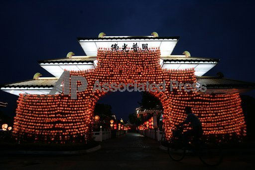 Chinese New Year.   A man rides a bicycle past an entrance gate decorated with the Chinese traditional lanterns at Fo Guang Shan Dong Zen Buddhist Temple in Jenjarom, outside Kuala Lumpur, Malaysia, Saturday, Jan. 29, 2011.   <span class=meta>( &#40;AP Photo&#47;Lai Seng Sin&#41;)</span>