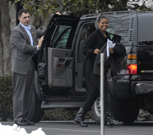 "<div class=""meta ""><span class=""caption-text "">First lady Michelle Obama exits her vehicle and heads into the White House in Washington Saturday, Jan. 29, 2011, after attending daughter Sasha's basketball game with President Barack Obama. (AP Photo/Susan Walsh) (AP Photo/ Susan Walsh)</span></div>"