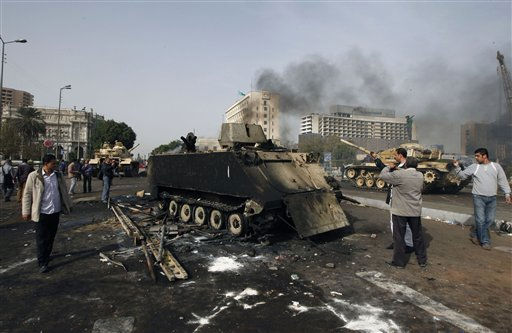 "<div class=""meta image-caption""><div class=""origin-logo origin-image ""><span></span></div><span class=""caption-text"">Egyptians photograph a burned out army armored personnel carrier in downtown Cairo, Egypt, Saturday, Jan. 29, 2011. (AP Photo/Khalil Hamra) (AP Photo/ Khalil Hamra)</span></div>"
