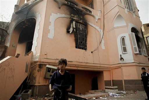 An Egyptian boy stands in front of a burned and looted police station, in the Darb al Ahmar neighborhood of Cairo, Egypt, Saturday, Jan. 29, 2011. &#40;AP Photo&#47;Tara Todras-Whitehill&#41; <span class=meta>(AP Photo&#47; Tara Todras-Whitehill)</span>
