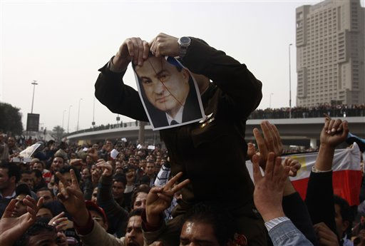 An army officer who joined anti-government protester tears up a picture of Egyptian President Hosni Mubarak, downtown Cairo, Egypt, Saturday, Jan. 29, 2011. &#40;AP Photo&#47;Ahmed Gumaa&#41; <span class=meta>(AP Photo&#47; Ahmed Gumaa)</span>