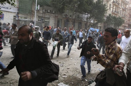 "<div class=""meta ""><span class=""caption-text "">Anti-government protesters throw stones during clashes on the sidelines of a demonstration in Tahrir Square, Cairo, Egypt, Friday, Feb. 4, 2011. Tens of thousands packed central Cairo Friday, waving flags and singing the national anthem, emboldened in their campaign to oust President Hosni Mubarak after they repelled pro-regime attackers in two days of bloody street fights.  (AP Photo/Khalil Hamra) (AP Photo/ Khalil Hamra)</span></div>"