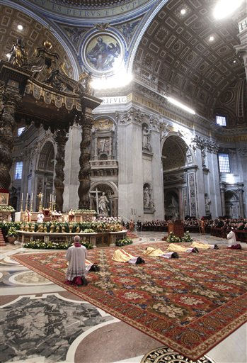 "<div class=""meta image-caption""><div class=""origin-logo origin-image ""><span></span></div><span class=""caption-text"">Newly ordained bishops lie on the ground in front of the altar during a ceremony in St. Peter's Basilica, at the Vatican, Saturday, Feb. 5, 2011. Pope Benedict XVI insisted Saturday on his exclusive right to ordain bishops as he consecrated a Chinese prelate in an implicit challenge to attempts by China's official church to ordain bishops without his approval. (AP Photo/Pier Paolo Cito) (AP Photo/ Pier Paolo Cito)</span></div>"
