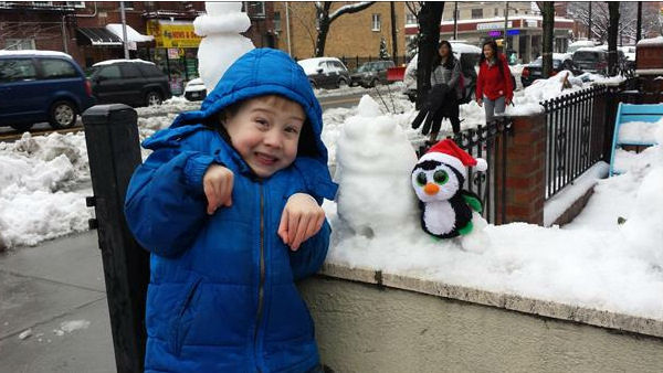 "<div class=""meta ""><span class=""caption-text "">Gehrig and the snow penguin. Photo Credit: Becca S. </span></div>"