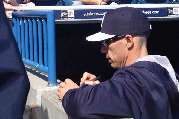 "<div class=""meta ""><span class=""caption-text "">Yankees Manager Joe Girardi signs autographs in Tampa, Florida.  (WABC Photo/ Rob Powers)</span></div>"