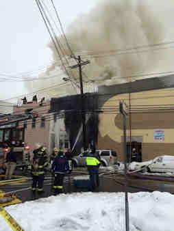 Fire officials rushed to the scene to battle a 5 alarm blaze inside a residential building in Weehawken, New Jersey.